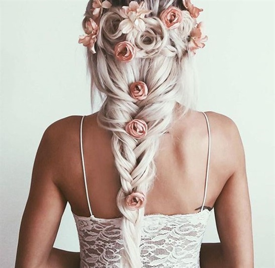 Beautiful Wedding Hairstyle with Braid and Flowers.  Floral braided hairstyles are a simple and stylish hairstyle that is perfect for all face shapes, but they are only an option for women with medium or long hair. Those with short hair will be much more limited, but of course they can use extensions to get a beautiful bun.