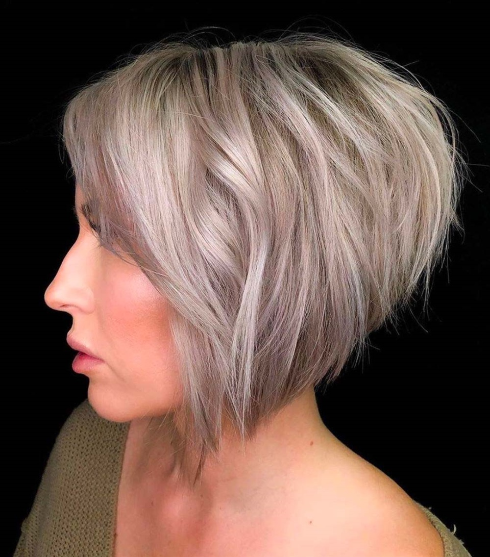 """Bob Hairstyles Short at the Back The perfect look to show off even on the red carpet. Long hair in front and short in back, with """"special effects"""" coloring."""