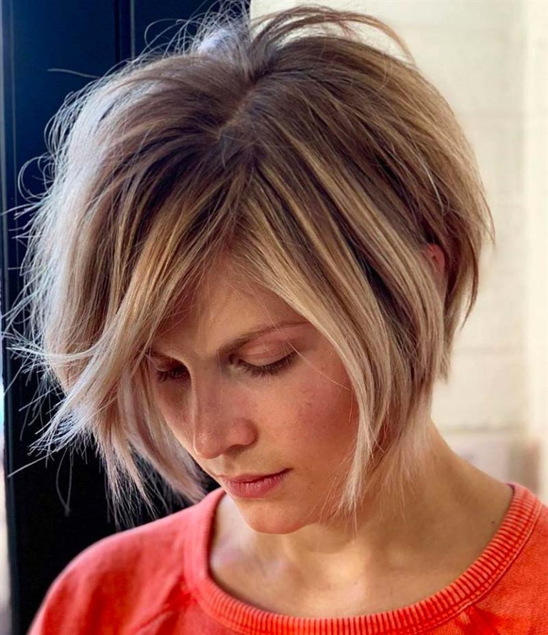 Bob Hairstyles for Messy and Inverted Hairs A messy but trendy look, which uses several layers of length (up to the chin) to effectively enhance the facial features.