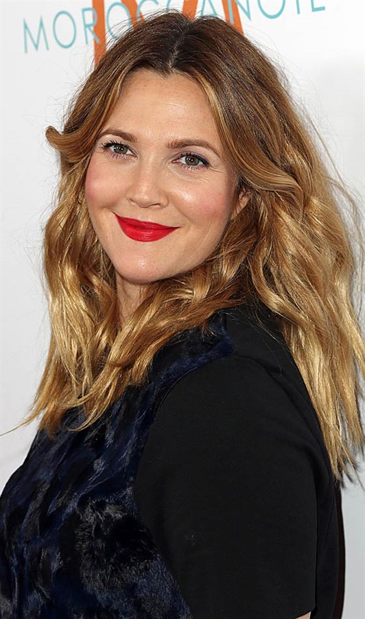 Hairstyles for Round Faces Over 40  Drew Barrymore has the most delicious round faces. Here she went for a center parted look that makes her appear longer and slimmer. Opt for this hairstyle when you are in the mood for a casual and effortless hairstyle.