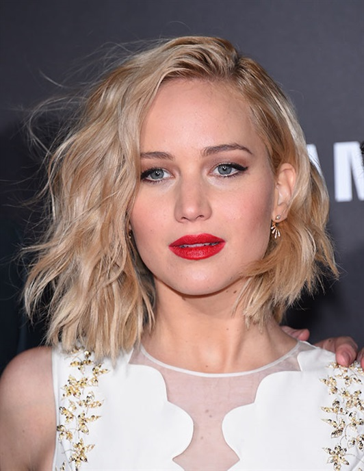 Hairstyles for Round Faces with Shaggy Bob  Jennifer Lawrence is undoubtedly the person to look to for hairstyle inspiration for your round face. It is absolutely swinging its asymmetrical weight which draws the eyes downwards. Styled in bristly waves and a side parting, this bob works wonders at offsetting her round face structure.