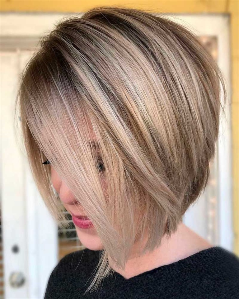 Inverted Bob Hairstyles for Mid Long A classy angled Bob, with bangs that delicately frame the face. Even more beautiful if enriched with different shades of color.