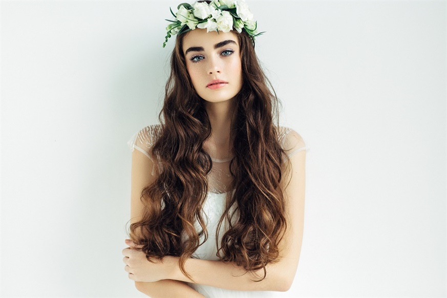 Wedding Hairstyles Flowers in the Long Hair  This model is often used for outdoor country weddings. It gives a full summer breeze to the guests.
