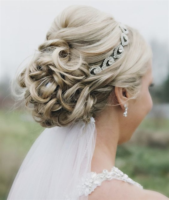 Wedding Hairstyles for Blonde Women Updo Style  Image with adorable hairstyle for a very sweet bride. A top-down updo model with a crown