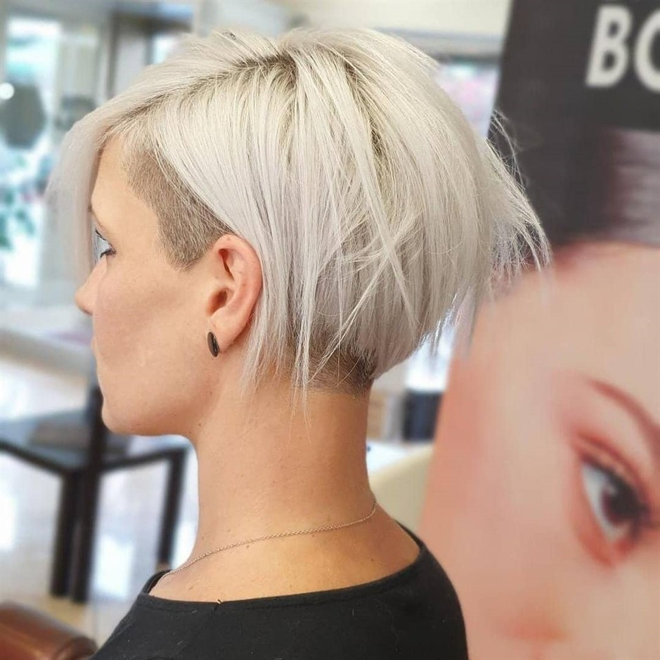 Asymmetric Short Hairstyles for Fine Hair and Back Side Shaved  Brave women prefer asymmetrical hairstyles. A beautiful model with shaved back and sides of your hair.