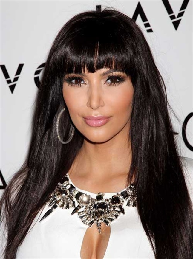 Long Hairstyles with Bangs Kim Kardashian Kim Kardashian is pretty much always seen with super well-groomed hair. Her long dark hair is here paired with a straight cut bangs, where not one hair sits wrong.