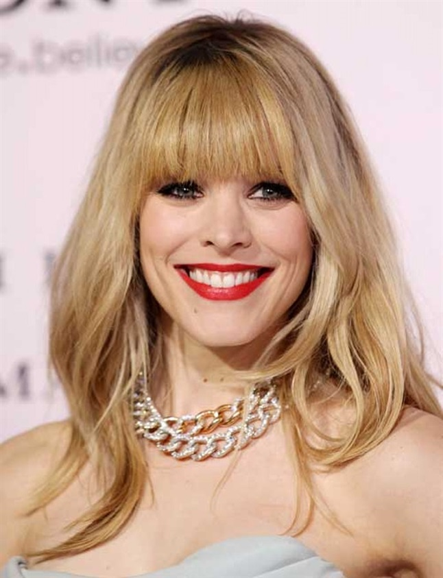 Long Hairstyles with Bangs Women Actress Rachel McAdams has been seen with a sea of different hair colors and hairstyles. Here she has long floor-cut blonde hair and a heavy and straight-cut bangs.