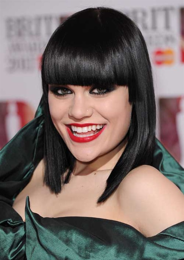Medium Hairstyles with Bangs for 2021 Jessie J is for contours and sharp edges. She is razor sharp with her black bangs cut perfectly straight.