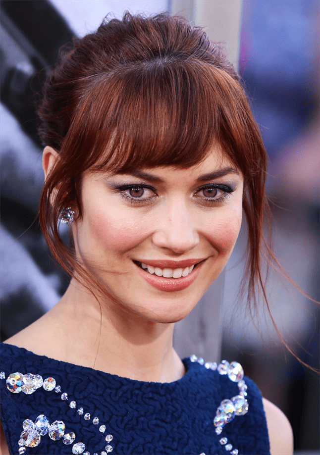 Olga Kurylenko Hairstyles with Bangs Bangs really come into their own when the rest of the hair is set up. Here it is James Bond actress Olga Kurylenko with bangs split at the side.
