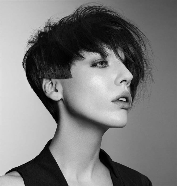 New Short Hair Style Asymmetrical Layered  Asymmetrical cut is indispensable for short hair. Asymmetrical cuts taper towards the ear. A great model in perfect harmony.